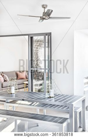Modern Dining Area Close Up From The Outside Near To Living Room Entrance Of A Luxury  House, Table