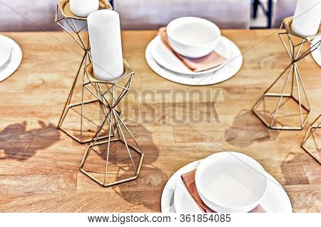 Metal Fancy Items Like Gold Candelabra On The Table With White Candles And Dining Table Set Up With
