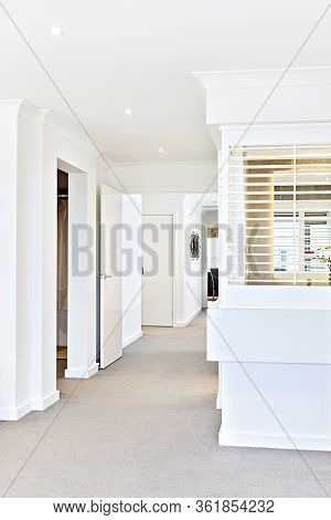 House Hallway Interior With Open Doors To Rooms That Fixed To White Walls Around, The Window Can Be