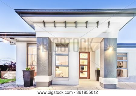 Modern House Front Close Up With Doors And Windows Beside Facade Including Big Concrete Pillars Illu