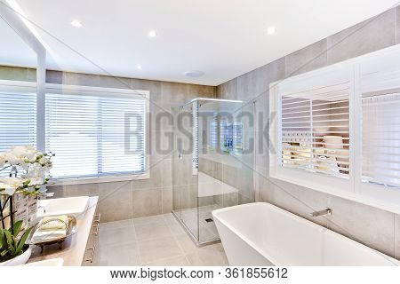 Modern Bathroom With A Washbasin And Shower Area  Near To White Windows Around, The Sunlight Came Th