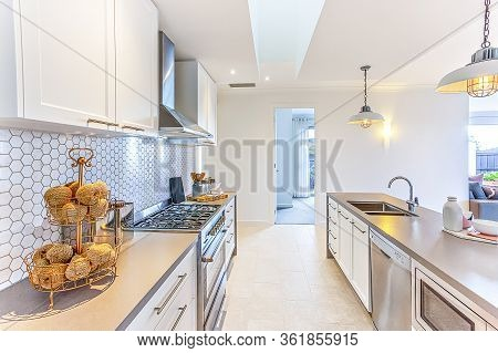 Modern Kitchen With Fancy Items Like Thread Balls On A Small Rack On The Counter Which Has A Stove N