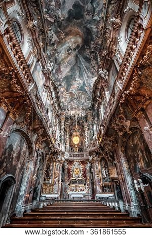 Feb 2, 2020 - Munich, Germany: Interior Of Asamkirche Baroque Church With Altar And Ceiling View