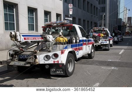 Toronto, Ontario, Canada - 06/25/2010 : Police Tow Trucks In Downtown Toronto For The G20 Summit.
