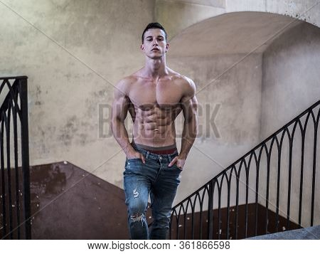 Muscular Shirtless Young Guy Standing On Stairway
