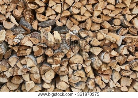 Pile Of Chopped Birch Firewood In Remote Russian Village. Woodpile, Logger, Sawn Trees, Background,