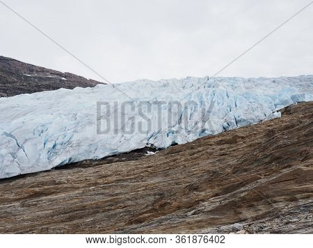 European Svartisen Glacier Tongue In Nordland County In Norway, Cloudy Sky In 2019 Cold Summer Day O