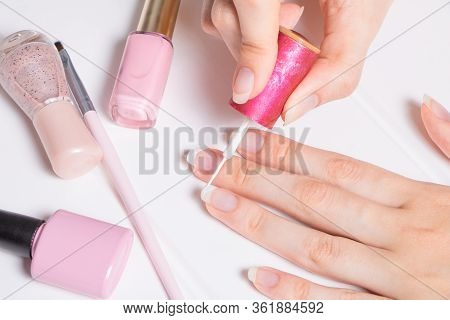 A Woman Paints Her Nails. The Girl Applies Nail Polish. Manicure, French, Nail Care. Nail Salon, Pro