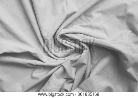 Wrinkled White Linen Bed Sheet Texture. Crumpled Used Cloth Pattern Of Clean Soft Linen Background.