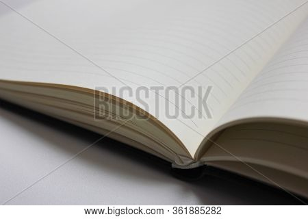 Note Book Open Pages Isolated On White Table Background. School And Education Conceptual Image, Blan