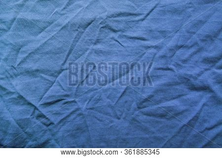Wrinkled Blue Fabric Texture, Crumpled Soft Cloth Background. Pale Blue Creased Clothes Pattern, Cot