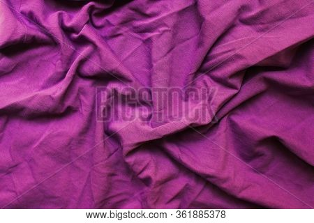 Crumpled Violet Texture Background Of Messy Cotton Fabric Detail. Wrinkled Soft Purple Color Cloth,