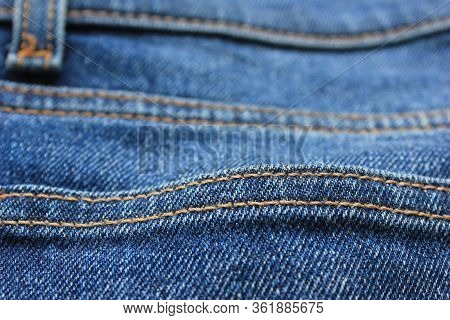 Jeans Fabric Background With Seam Pattern. Stitch On Casual Denim Jean Material Surface, Low Angle C