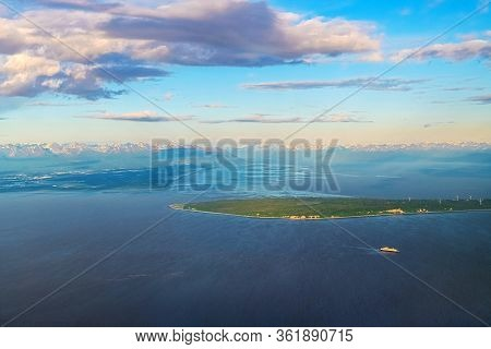 An Aerial View Of An Alaskan Landscape With Cruise Ship.