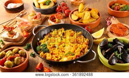 assorted of spanish dish- paella, tapas, olive, patatas bravas