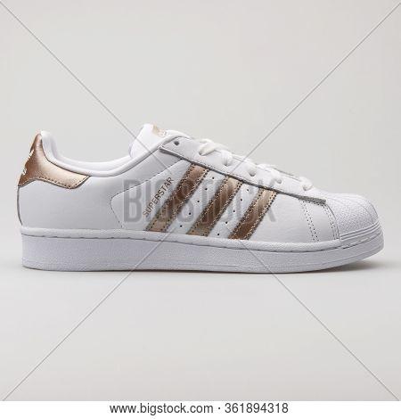 Vienna, Austria - August 29, 2017: Adidas Superstar White And Copper Sneaker On White Background.