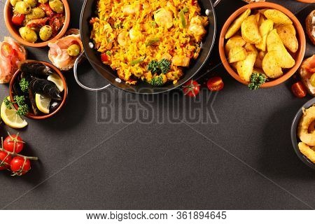 assorted of spanishfood with paella and tapas