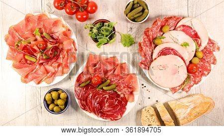 assorted of delicatessen, french charcuterie with salami, bacon, prosciutto ham