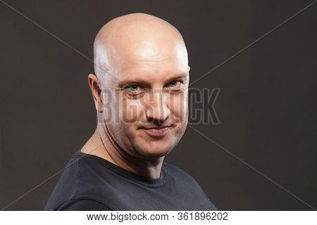 Portrait Of A Bald Man Close Up Smiling.
