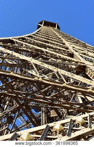 Tour Eiffel Or Eiffel Tower, Perspective From Below With Blue Sky From Champ-de-mars. Paris, France.