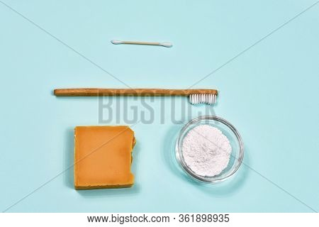 Zero Waste Concept. Toothbrush, Tooth Powder And Soap On A Blue Background. Eco-friendly Bamboo Toot