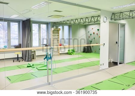 Gym with mirror and yoga mats in a gym or fitness center
