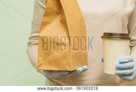Woman In Protective Medical Gloves Delivers Takeaway Food And Coffee. Delivery Service Under Quarant