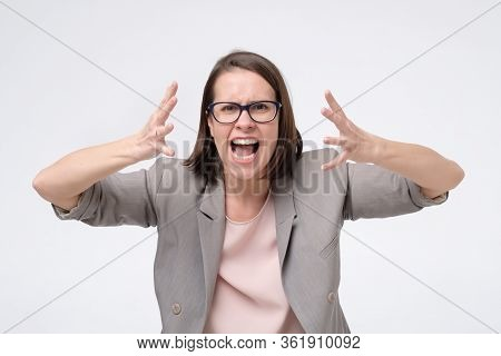Screaming, Hate, Rage. Crying Emotional Angry Woman Screaming On White Studio Background.