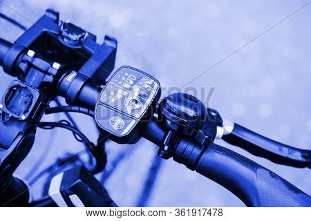 Close-up Macro Shot Of The Steering Wheel Of A Modern Electric Bicycle With Speed Controller And Hor