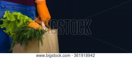 Delivery Man Wearing Protective Gloves Holds Paper Bag With Food