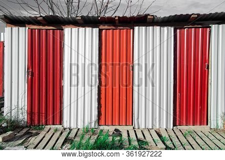 Vintage Rural Rustic Construction Tin Red And White Color Country Side Toilet Simple Ugly Architectu