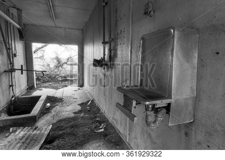 Non-functioning Drinking Fountain In An Abandoned Building