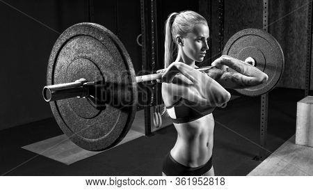 Woman With Barbell Caucasian Female Performing Deadlift Exercise With Barbell Confident Woman Crossf
