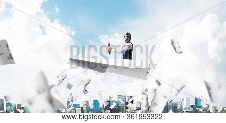 Business Accounting And Statistics Concept With Funny Pilot. Aviator Driving Paper Plane Above Falli
