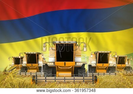 A Lot Of Yellow Farming Combine Harvesters On Farm Field With Mauritius Flag Background - Front View