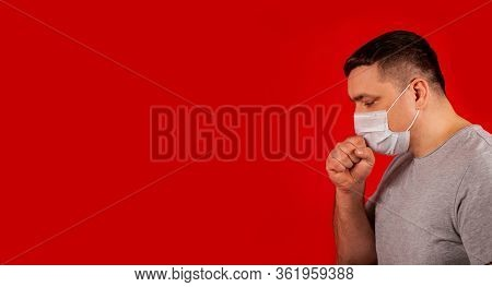 Portrait Of A Young Sick Man In A Medical Protective Mask Coughing And Feeling Ill. Sick Man Sick Wi
