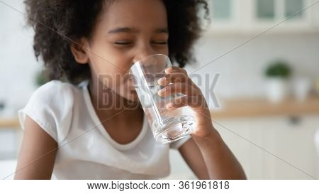 Little Biracial Girl Drink Pure Mineral Water