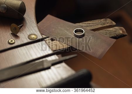 Gold Wedding Ring With Diamonds Hand-polished By A Jeweler. To Make The Jewel It Takes: Precision, C