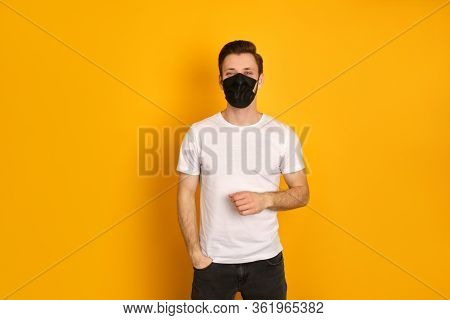 Caucasian Young Guy Wears Face Black Mask Because Of The Pandemia Of Covid19 Virus, Wants To Be Heal