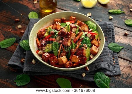 Healthy Vegan Fried Tofu Salad With Carrot, Red Bell Pepper, Spinach And Nuts