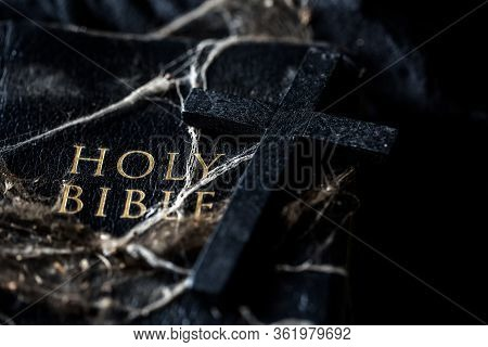 Crucifix On Dirty Holy Bible In Dark Vintage.
