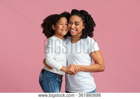 Love Of Mother And Daughter. Happy Black Family Mom And Child Hugging And Smiling At Camera, Posing