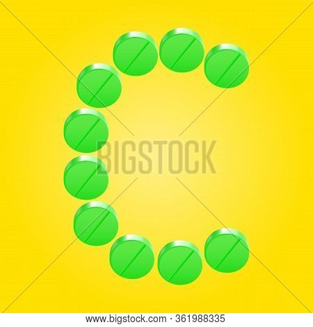 Letter C Was Written In A Green Tablets Of Vitamin C On Yellow Background