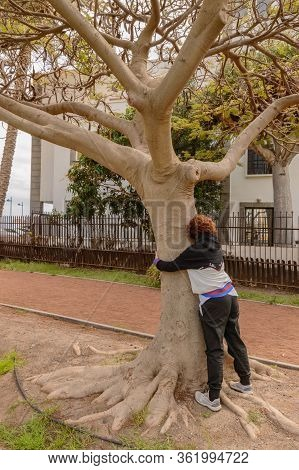 Pretty Red Haired Woman Embracing A Tree And At The Same Time Nature In The Torre Del Conde Park In