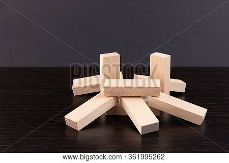 Wooden Building Blocks Tower On Wooden Background Top View With Copy Space. Wood Blocks Stack Game B