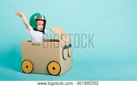 Happy Asian Children Boy With Helmet Smile In Driving Play Car Creative By A Cardboard Box Imaginati