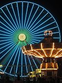 Ferris Wheel and Carousel in Amusement Park at Night poster