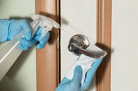 Disinfection, Cleaning And Washing Of Door Handles. Prevention Of Coronavirus Infection. Pandemic Co