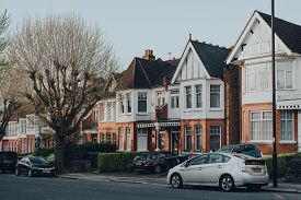 London, Uk - April 12, 2020: Cars Parked In Front Of A Row Of Edwardian Houses On A Street In Palmer