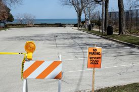 A parking lot is closed near a well known suburban beach along the shores of Lake Michigan in Glencoe, Illinois to promote social distancing and home isolation during the coronavirus pandemic of 2020.